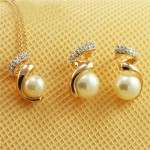 Rhinestone and Pearl Embellished Swirling Design Rose Gold Necklace and Earrings Set