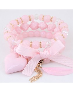 Peach Heart Bowknot and Feather Pendants Three Layers Beads Combo Fashion Bracelets - Pink