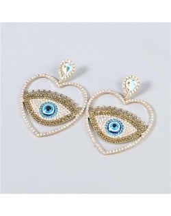 Heart Shape Hollow-out Eye Rhinestone Inlaid U.S. Fashion Women Party Costume Wholesale Earrings - Luminous White